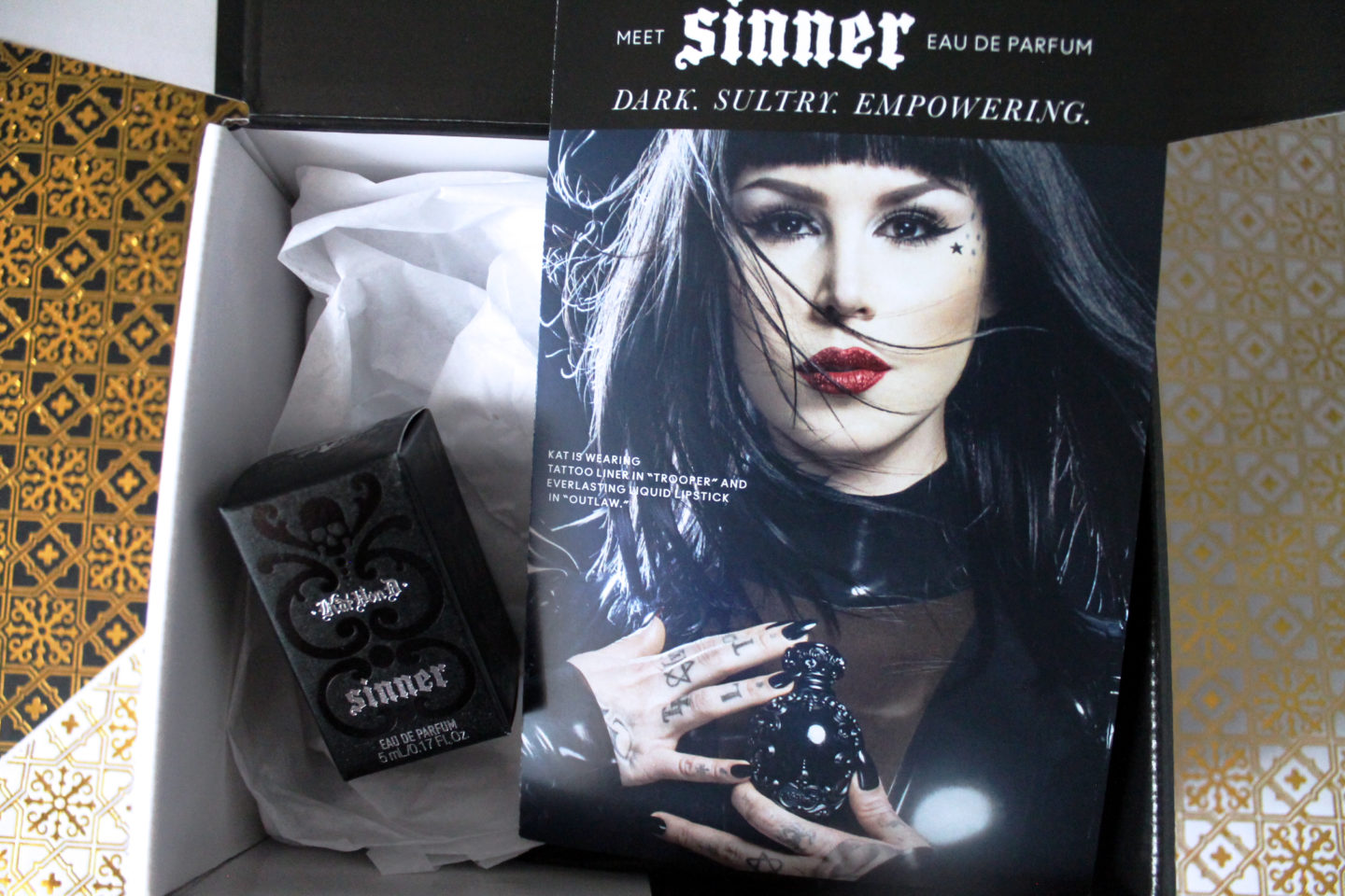 Sinner Perfume and Pamphlet